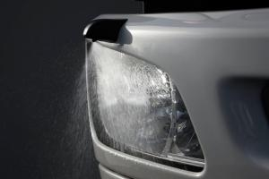 HID headlamps with auto-leveling and washer